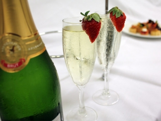 Complimentary glass of sparkling on board High Tea Cruise